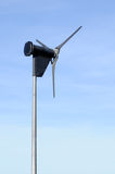 Small Wind Turbine. Against a bright blue sky Royalty Free Stock Photos