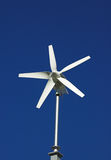 Small wind turbine. Generating alternative green energy Stock Images