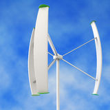 Small wind turbine in a blue sky background Stock Images