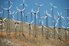 Small Wind Turbines on Hillside Royalty Free Stock Images