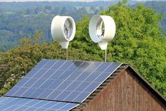 Small wind turbines and solar roof Royalty Free Stock Photography