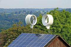 Small wind turbines and solar roof Royalty Free Stock Photos