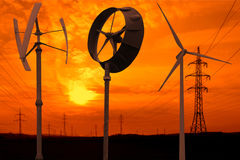 Small wind turbines in the sunset Royalty Free Stock Images