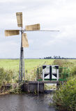 Small windmill for pumping water in dutch polder near Huizen and Stock Photography