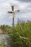 Small windmill for pumping water in dutch polder near Huizen and Royalty Free Stock Photography