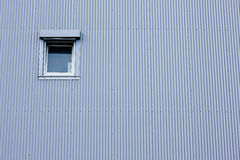 Small window. On a supermarket wall Royalty Free Stock Photography