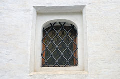 Small window of the ancient building of white color Stock Images