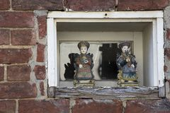Small window with Chinese figurines royalty free stock photo