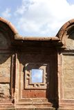 Small window in the historical wall Royalty Free Stock Images
