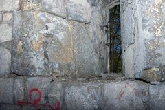 Small window in an old castle tower stock photos