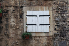Small window in an old house Stock Image