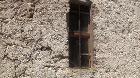 Small window on the orthodox temple in the mountain. This is a footage of Small window on the orthodox temple in the mountain stock video