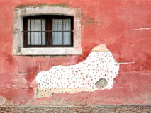 Small window on plastered wall Royalty Free Stock Image