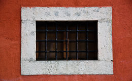 Small Window on red wall Royalty Free Stock Image