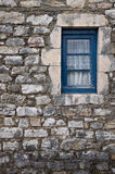 Small window on a stone wall Royalty Free Stock Photos