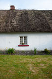 Small window on traditional irish thatched cottage Royalty Free Stock Images