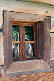 Window in the wall of an old wooden house Royalty Free Stock Photos
