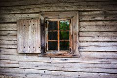 Small window in the wall of an old wooden house.  Stock Photos
