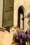 Small window with wisteria flowers in Asolo Stock Photo