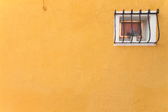Small window from a yellow house in Burano island, Venice Stock Photography