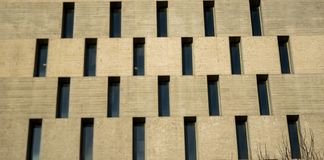 Small windows in a building. A picture of small windows like a texture,,in a big building,in a town in Greece.Thessaloniki Stock Photography