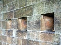 Small Windows in Sandstone Wall Royalty Free Stock Photos