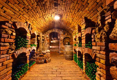 Small wine cellar with bottles and keg Stock Image