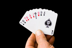 Small Winnings. A 500 hand of miniature playing cards, isolated on black, with clipping path Stock Photo