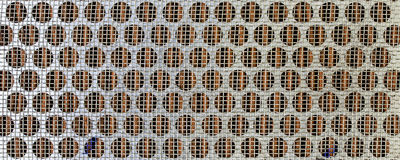 Small wire grate. knit together a panel. Royalty Free Stock Photos