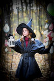 Small witch. Girl dressed in a fall Halloween witch costume stock photos