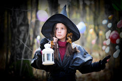 Small witch. Girl dressed in a fall Halloween witch costume royalty free stock image