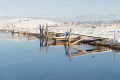 Small wodden bridges reflecting in the water in the wintry archi Royalty Free Stock Photography