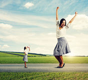 Small woman and big woman Royalty Free Stock Image