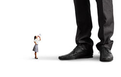 Small woman screaming at big boss. Over white background stock photos