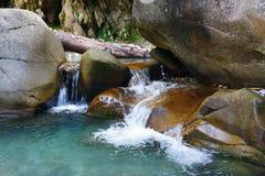 Small wonderful refreshing waterfalls among rocks. Small wonderful refreshing waterfalls among the rocks Stock Photo