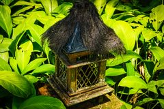 Small wood and bamboo temple in the middle of green leaf - photo indonesia stock photos