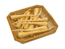 Parsnips in a wood basket. A small wood basket filled with whole parsnips isolated on a white background Royalty Free Stock Photography