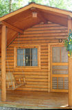 Small wood cabin. Front porch and door of small wood cabin Royalty Free Stock Photos