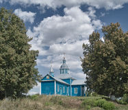 Small wood church with clouds over Royalty Free Stock Photography