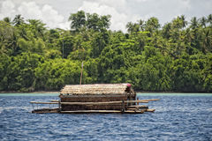 Small wood floating fishing platform Stock Photo