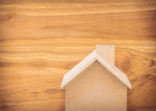 Small wood house model on brown background Stock Photo