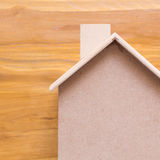 Small wood house model on brown background Stock Image