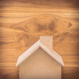 Small wood house model on brown background Royalty Free Stock Photo