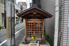 Small wood joss house or wooden little shrine on street of small Royalty Free Stock Images