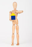 Small wood mannequin holding colourful blocks Royalty Free Stock Photography