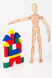 Small wood mannequin stand building blocks Stock Photos