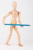 Small wood mannequin standing with colour pencil isolated on whi Stock Images