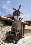 A small wood mill on the roof Royalty Free Stock Photo