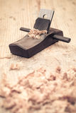 Small wood planer and shavings closeup Royalty Free Stock Photos