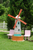 Small wood turbine on green garden Royalty Free Stock Images